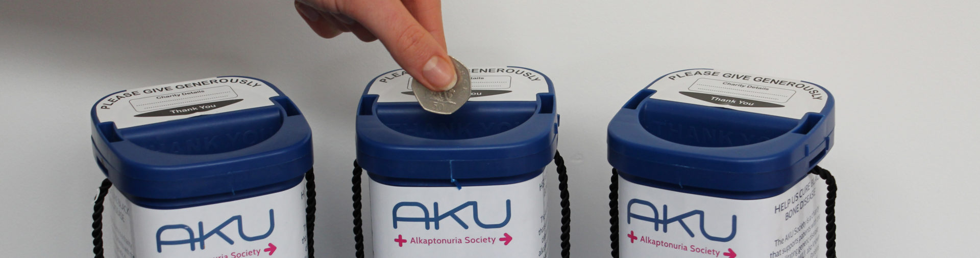 money being donated to the aku society charity blue pot